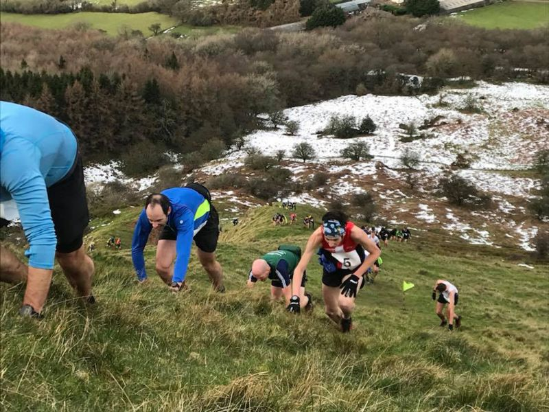 James Thomas in the Skirrid Fell Race, in the red vest. Look closely and you can just make out his wife Liz in the red vest at the bottom of the hill