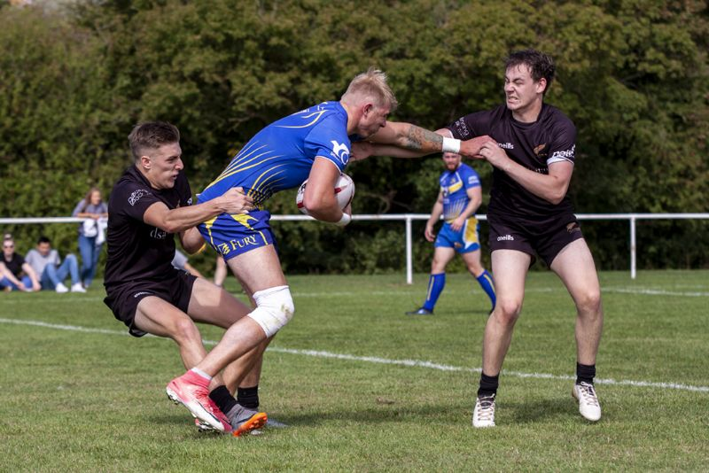 Callum Merrett, left, and Joe Uren try to tie down Telford's James Derry. Picture, Lewis Mitchell