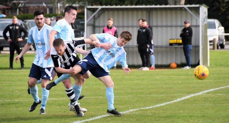 Action from Little Stoke against Gala Wilton (blue). Picture, Pete Langley