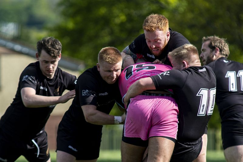 The Cougars' Anton Ramsey is tackled by a group of All Golds players, left to right, Joe Uren, Luke Stephens, Paul Bolger, Mike Addis and Joe Collins. Picture, Lewis Mitchell Photography