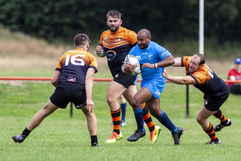 Marcus Brown tries to make inroads into the Tigers' defence. Picture, Lewis Mitchell Photography.