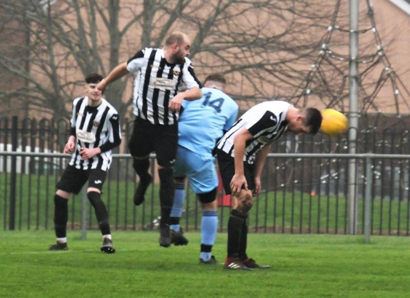 Action from Patchway Town, in black and white, against Henbury