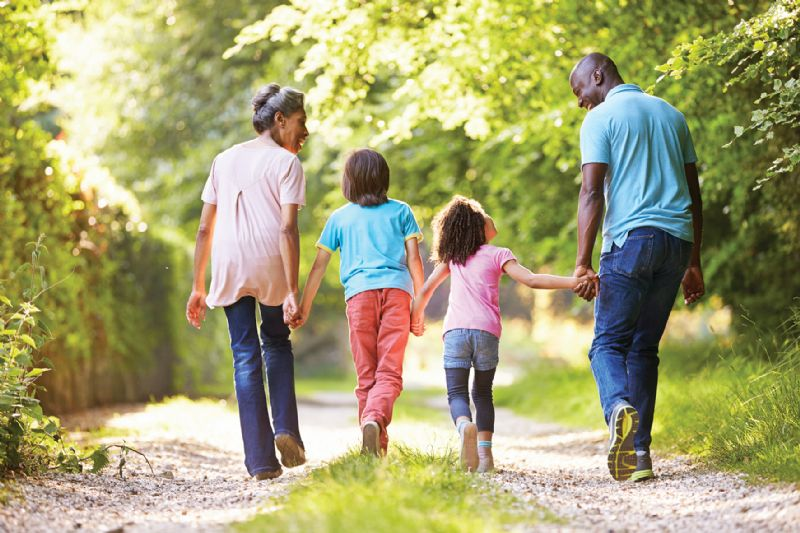 Family children grandparents walking in countryside happy smiling