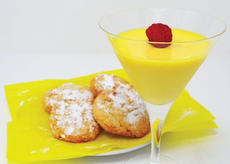 Refreshing citrus posset served with lemon and almond bites