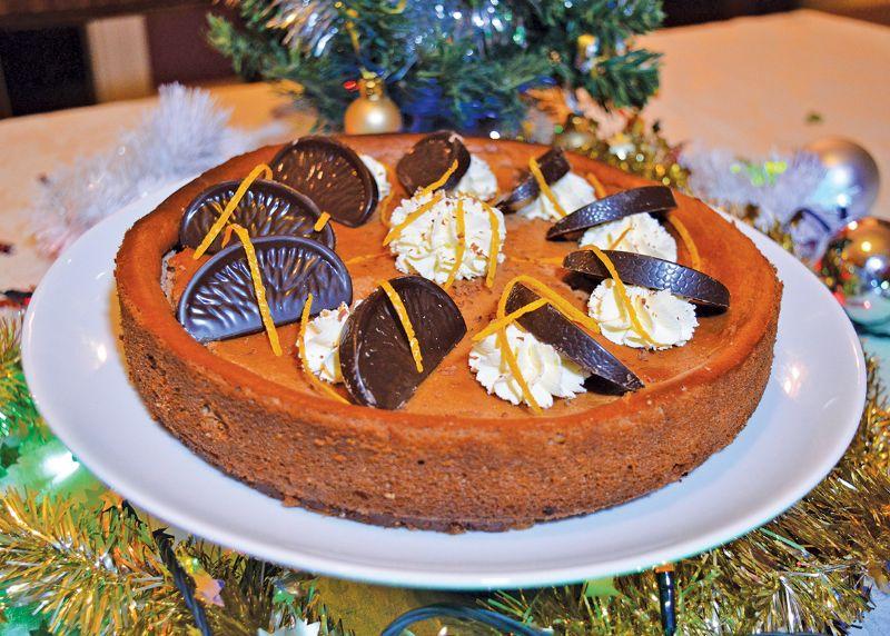 Baked chocolate and orange cheesecake festive dessert Christmas pudding