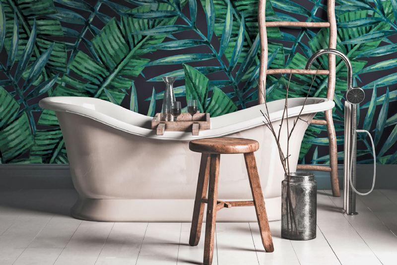 Bath in bathroom with green jungle wallpaper Wallsauce