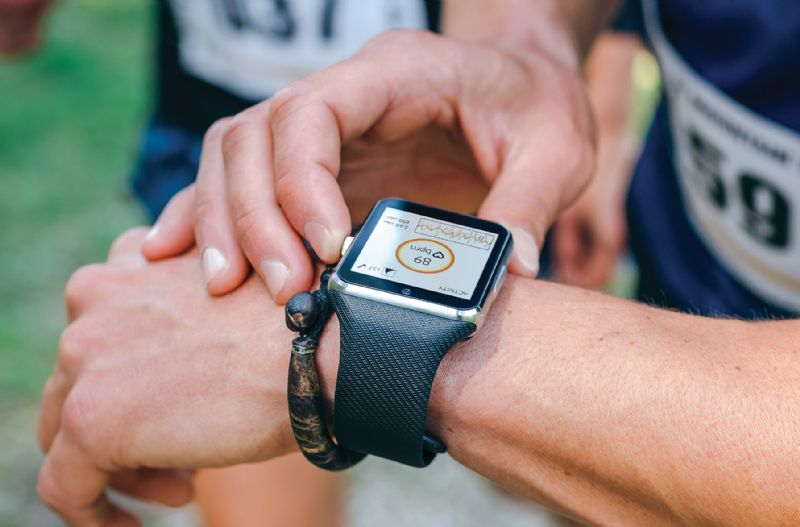 Man looking at fitness watch performance monitoring