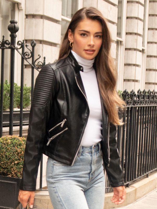 Woman wearing biker jacket autumn faux leather